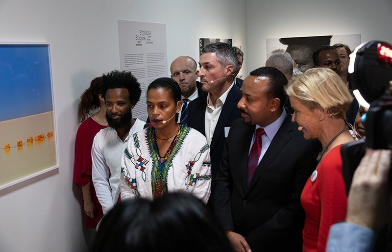 Group looking at print on wall at Nobel peace Prize